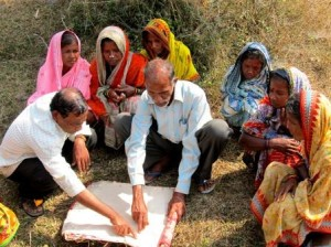 Women observing demarcation of their plots with Revenue Inspectors, Odisha Photo Credit: Landesa